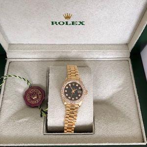 Rolex 18k diamond bezel watch